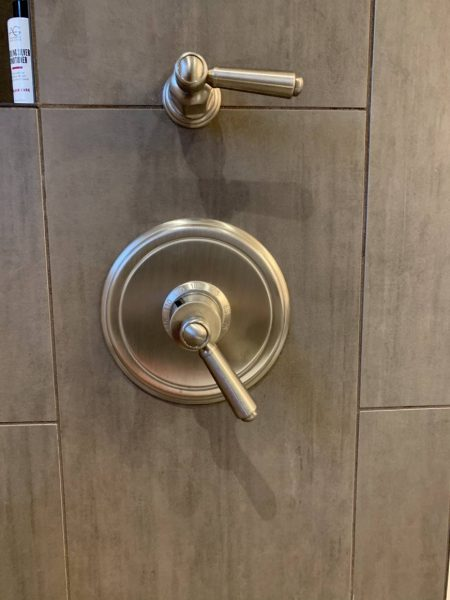 Place shower controls so you can turn on water without getting wet