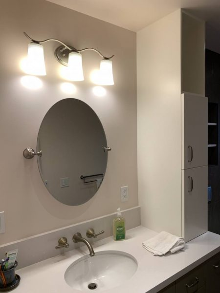 Bathroom vanity with tilt mirror