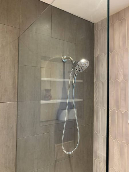 Handheld shower head in walk in shower