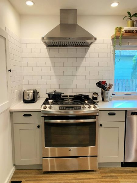 Easy to clean stove back splash with chimney hood.