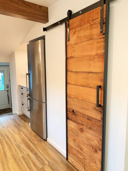 Homeowner made reclaimed wood pantry door.